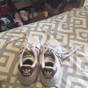 Pair of ladies adidas shoes.